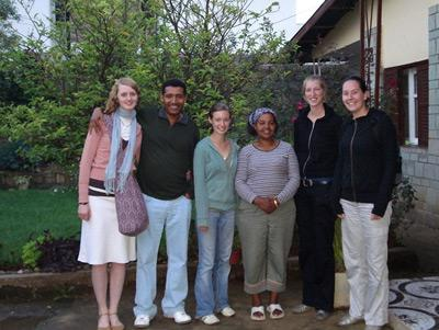 A host family in Ethiopia with their volunteers