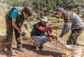Archaeology volunteers work on their excavation efforts at a placement in Peru