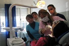 Dentist inspecting the teeth and gums of a patient