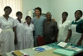 A volunteers poses with placement colleagues on a Dentistry Project based in Ghana