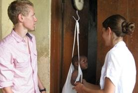 A Midwife volunteer interacts with a child on a placement in Ghana