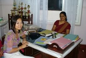 A Midwifery Elective intern sits with the director of her placement hospital in Sri Lanka.