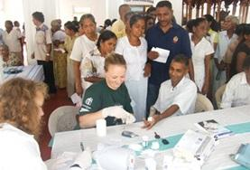 An intern doing her Physiotherapy Elective in Sri Lanka observes as a local physiotherapist demonstrates a treatment technique.