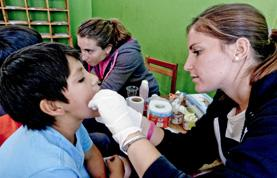 A Medicine volunteer inspects a patient on a placement in Peru
