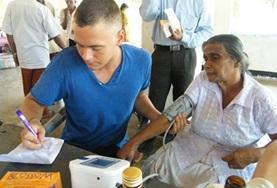 A Nursing volunteer in Sri Lanka conducts basic health checks at a hospital, contributing to his medical experience during his internship.