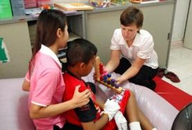 A volunteer interacts with children on an Occupational Therapy placement in Cambodia