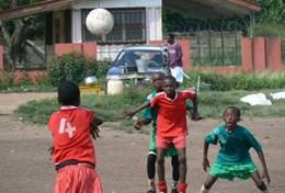 Children play football at a placement in Ghana