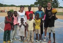 Volunteer and children pose for a picture at a placement in Ghana